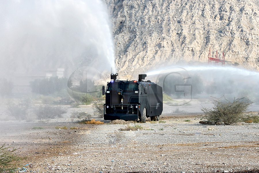 armored water cannon truck throw range